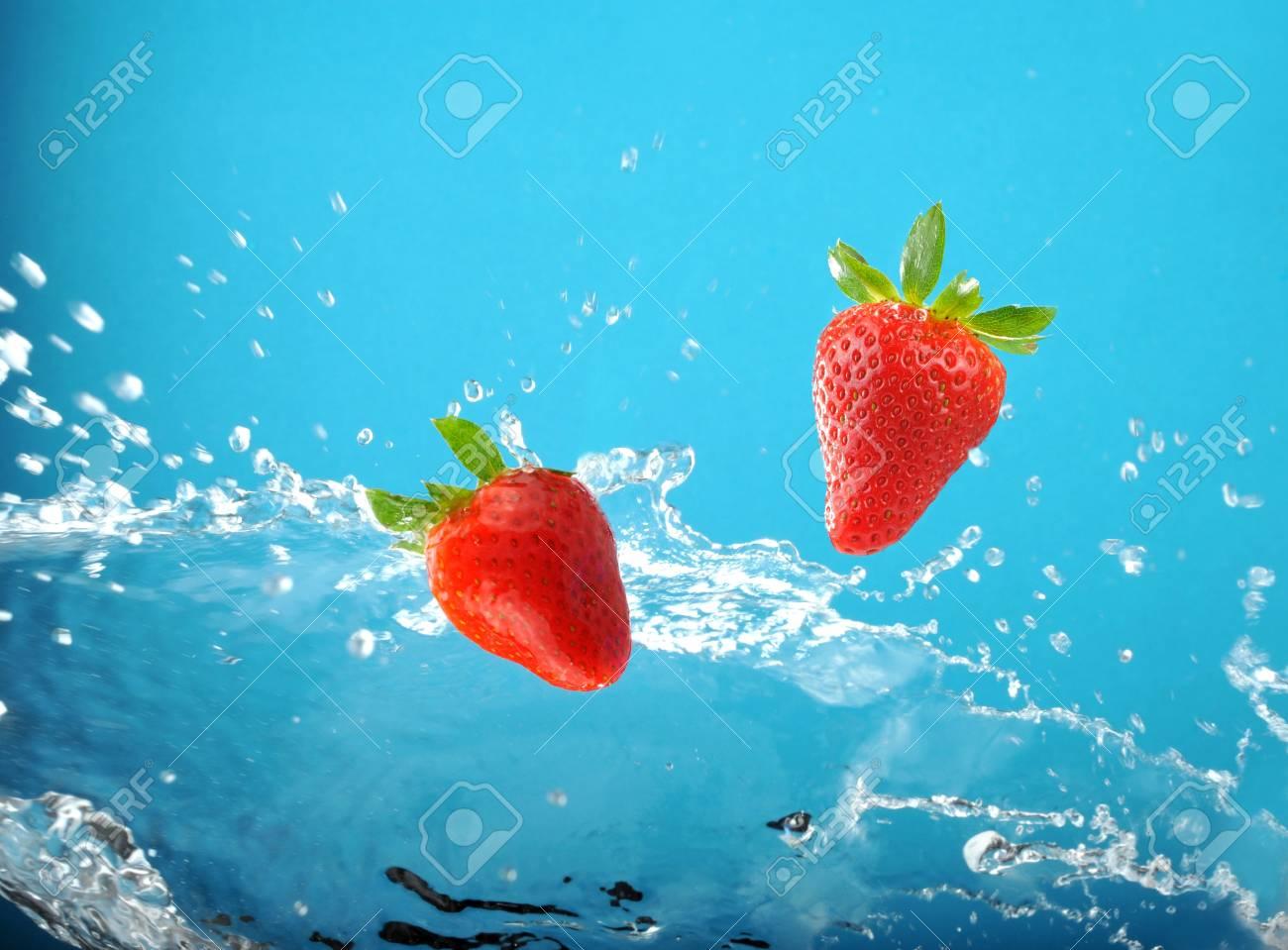 Fresh colored splash with strawberry Stock Photo - 4339597