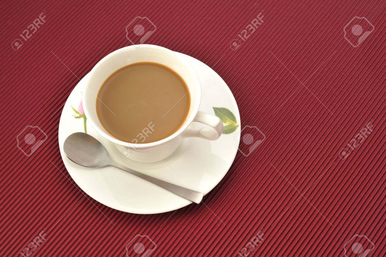 Coffee cup over red  background Stock Photo - 4725926