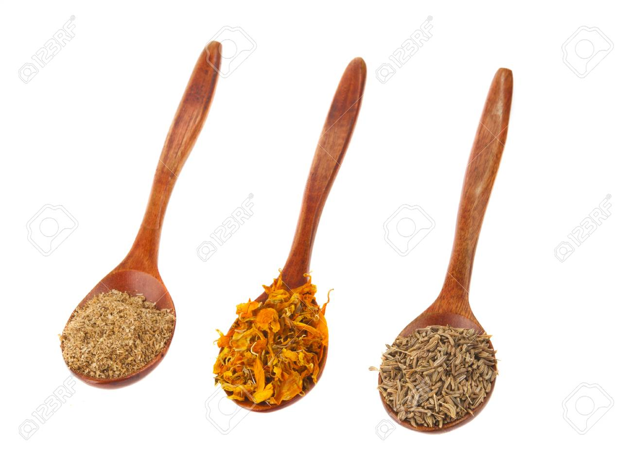 spice turmeric, coriander, cumin in wooden spoon isolated on a white background isolated on white background Stock Photo - 15901818