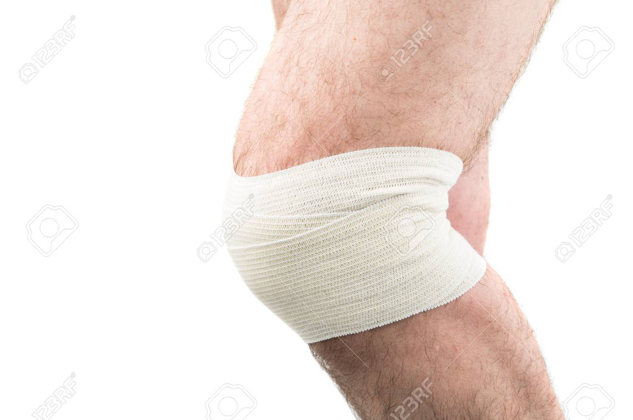 Man With Elastic Bandage On Knee Isolated On White Stock Photo