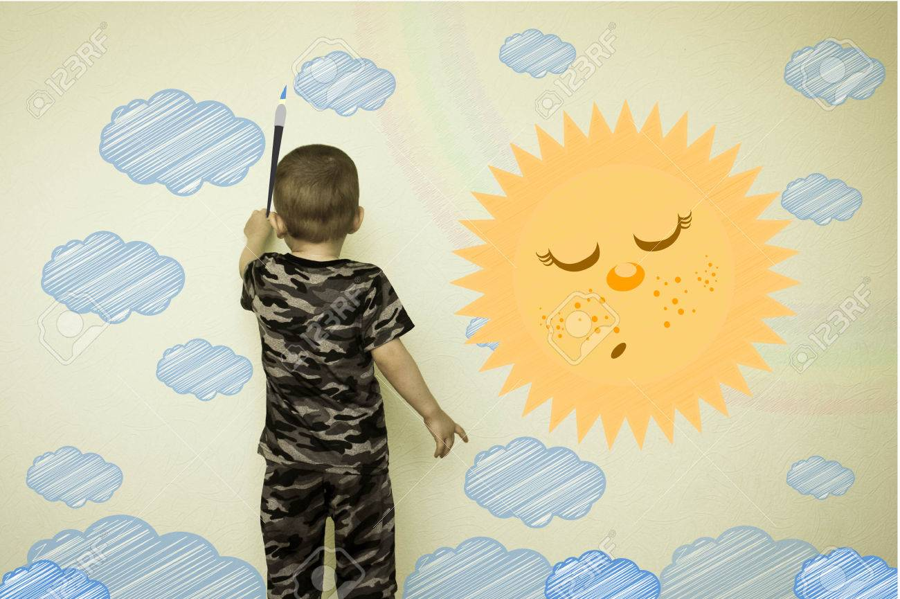Concept Of Creativity Child. The Little Boy Draws On The Wall ...