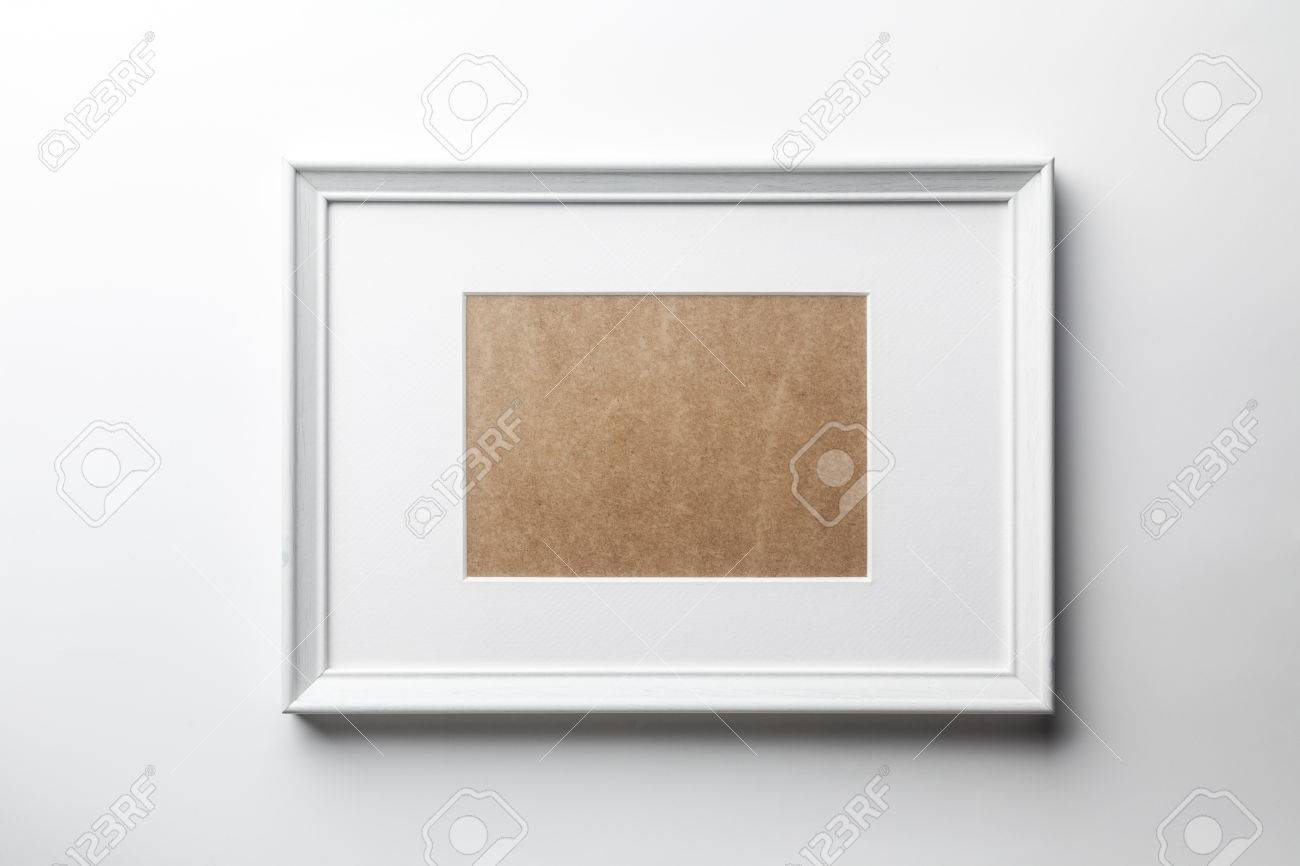 White plain empty wood picture frame with white mat passe-partout on white wall background - 52352154