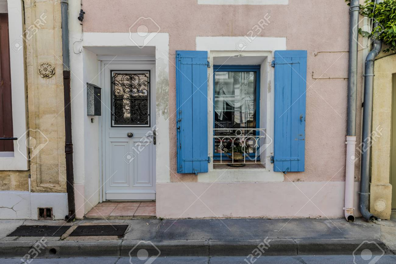 Pink French House With Blue Shutters At French Small Town Southern