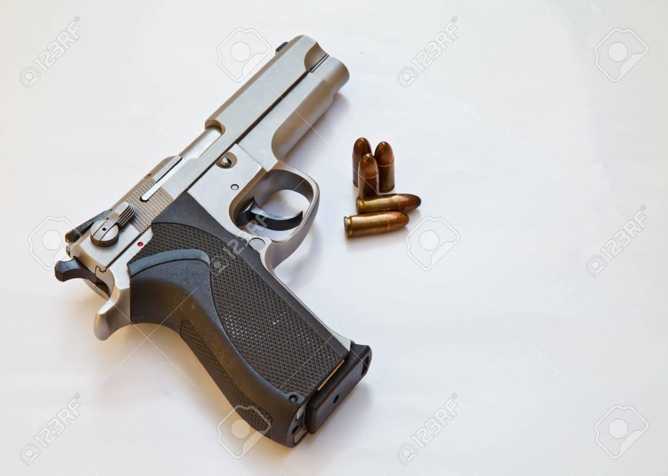 Semi-automatic pistol and bullets Stock Photo - 17113096