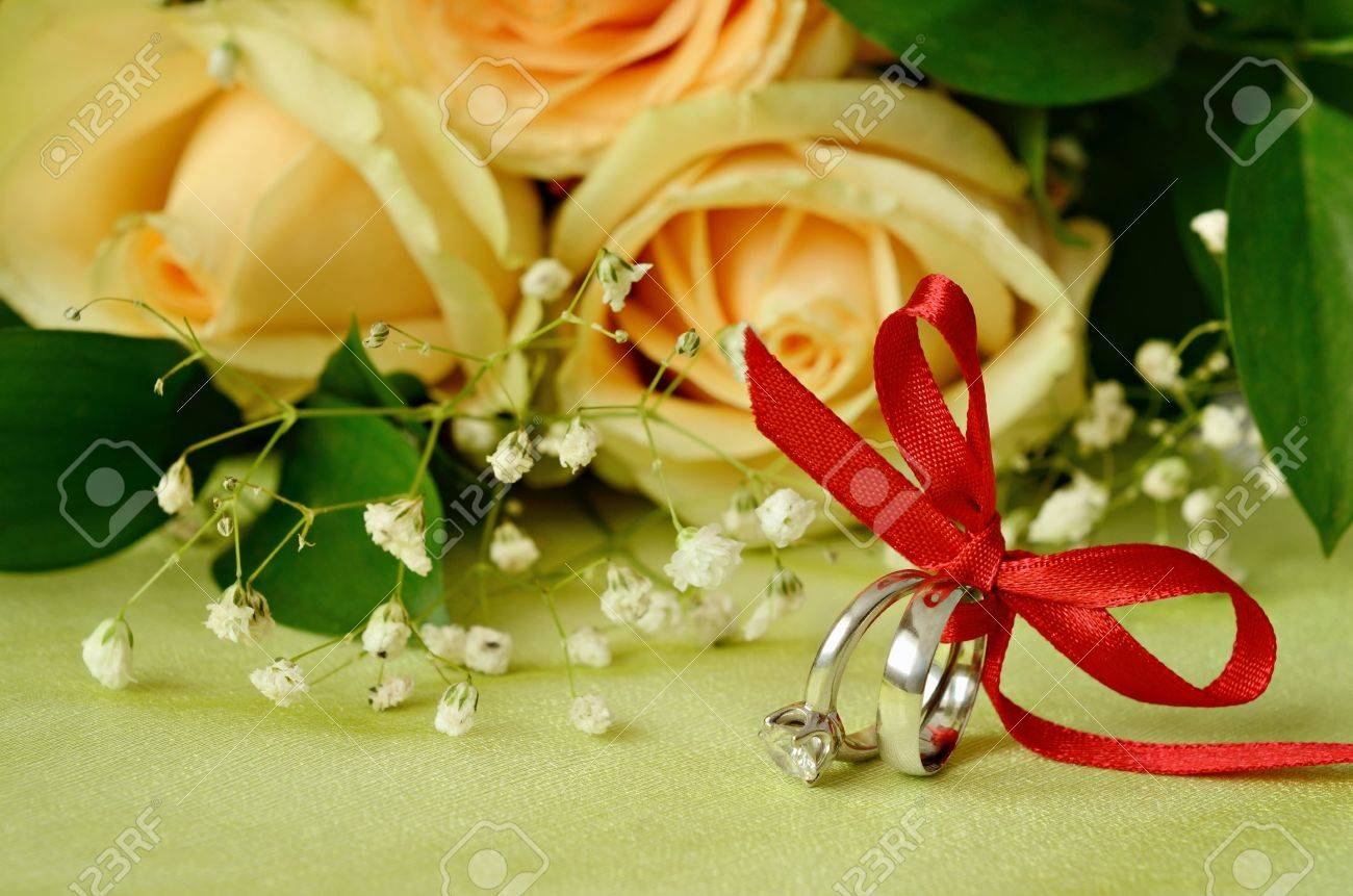 Engagement and wedding rings with roses Stock Photo - 21643764