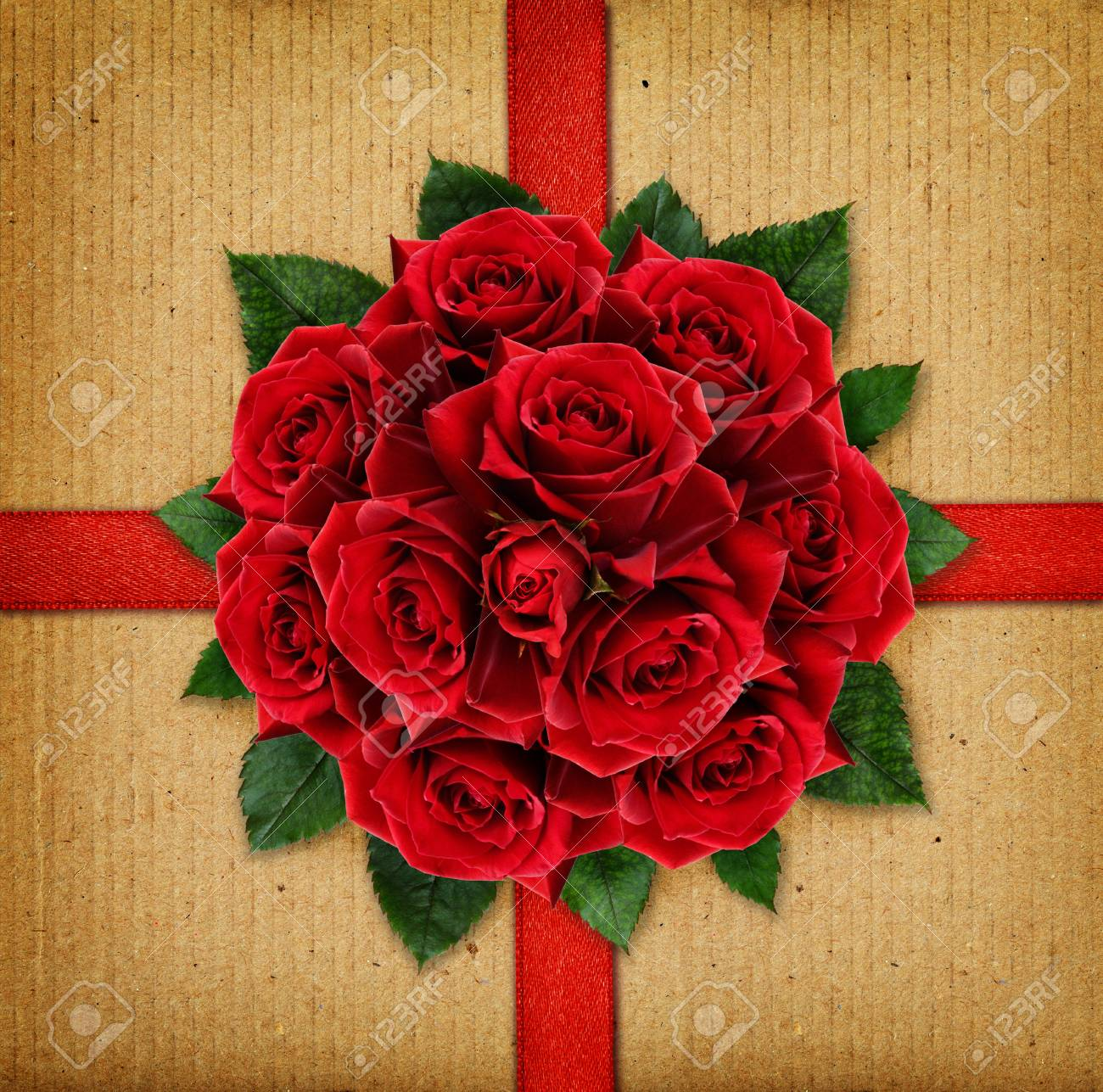 Red Rose Flowers Bouquet And A Ribbon On Cardboard Background Stock