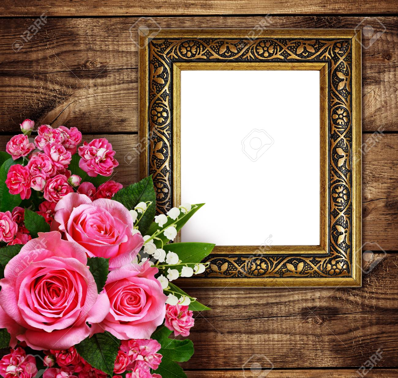 Pink Flowers Arrangement And A Frame For Photo Or Text On Brown