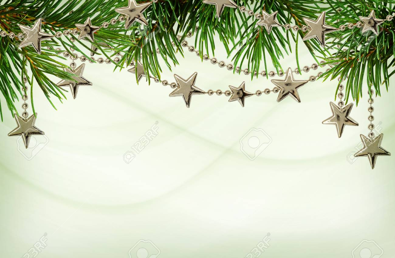 Christmas Top Border.Silver Garlands With Twigs Of Christmas Tree For Top Border On