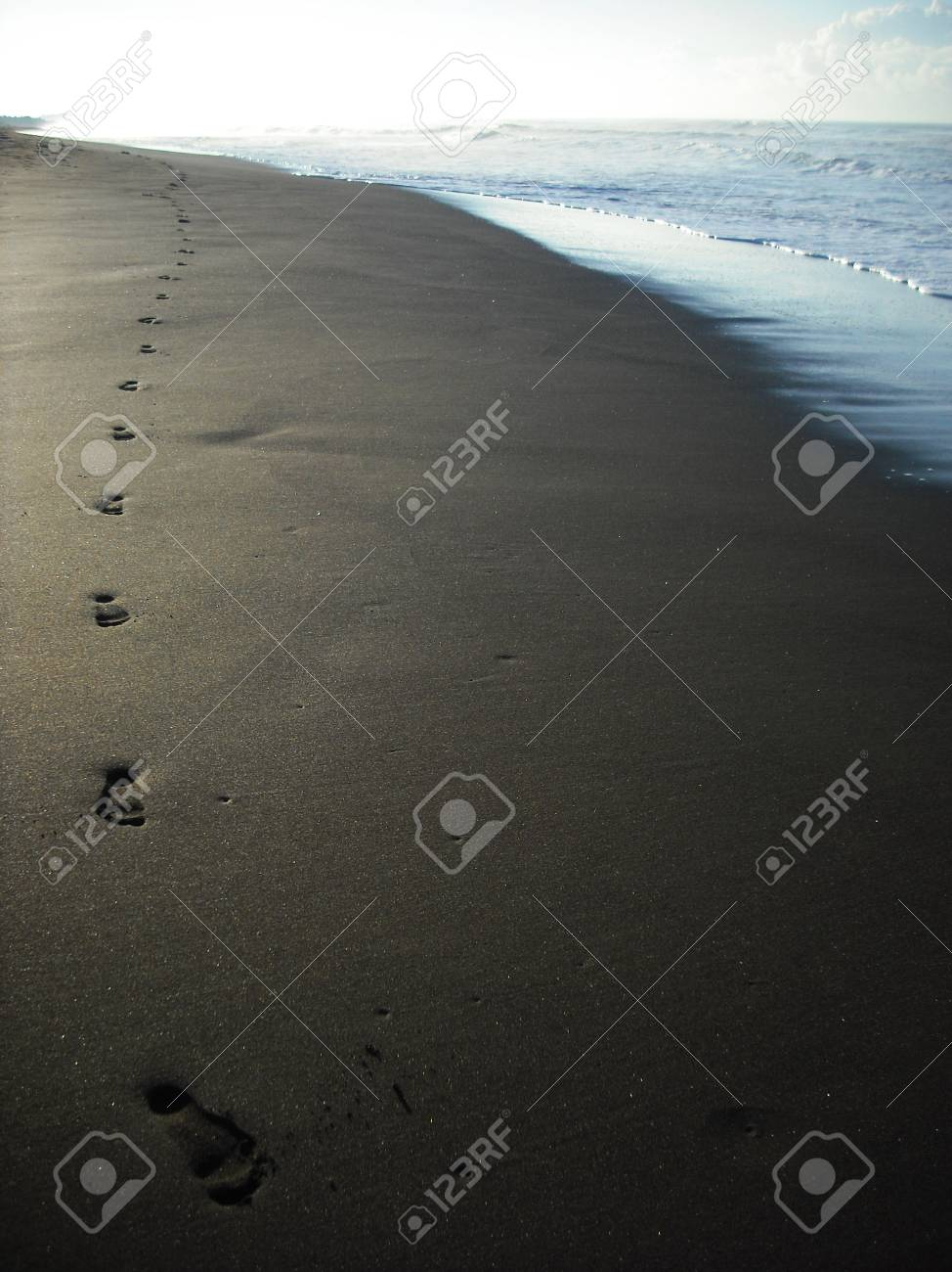 Footprints On Black Sand Beach In Costa Rica Stock Photo Picture