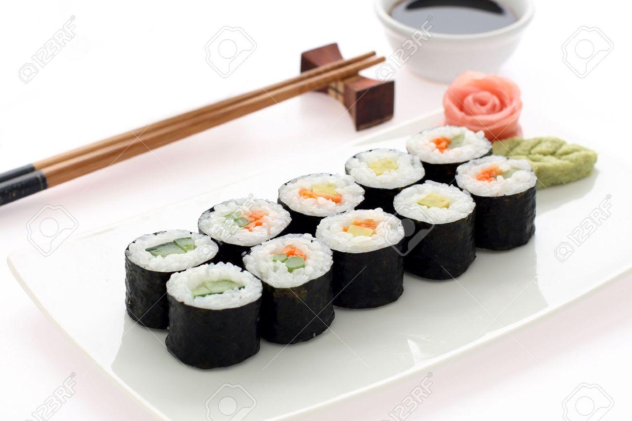 Makizushi. Delicious sushi rolls on white plate with chopsticks and wasabi. Maki Stock Photo - 10890603