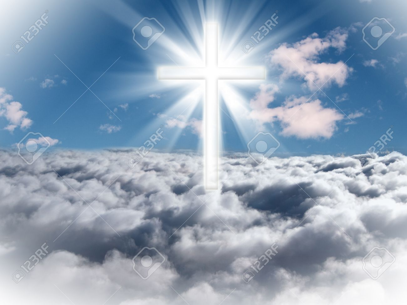 A cross in the sky with light rays on a bright sunny day. - 54766692