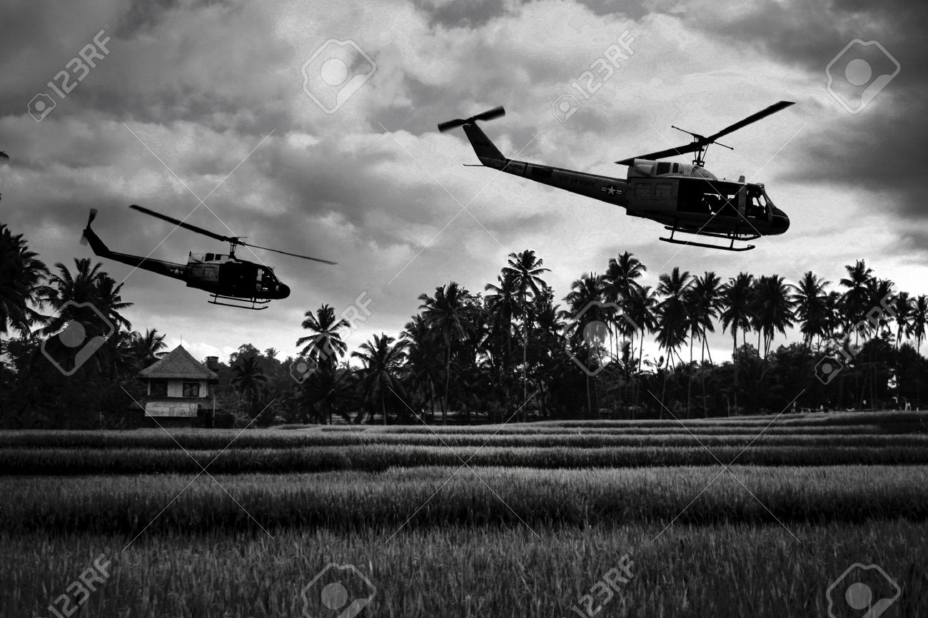 Vietnam War 'style' image circa 1970 two helicopters flying over