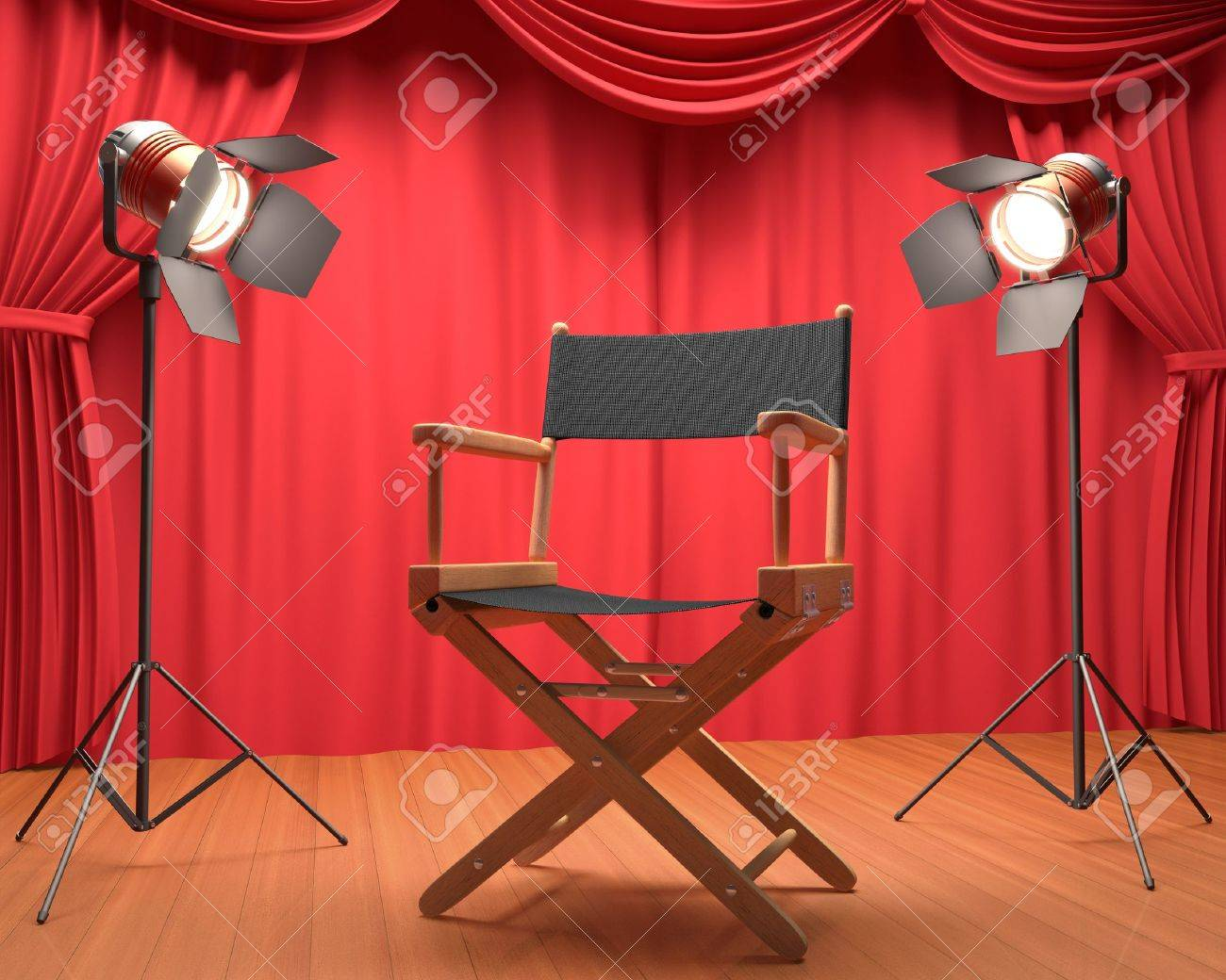 Director's chair on the stage illuminated by floodlights. - 16380381
