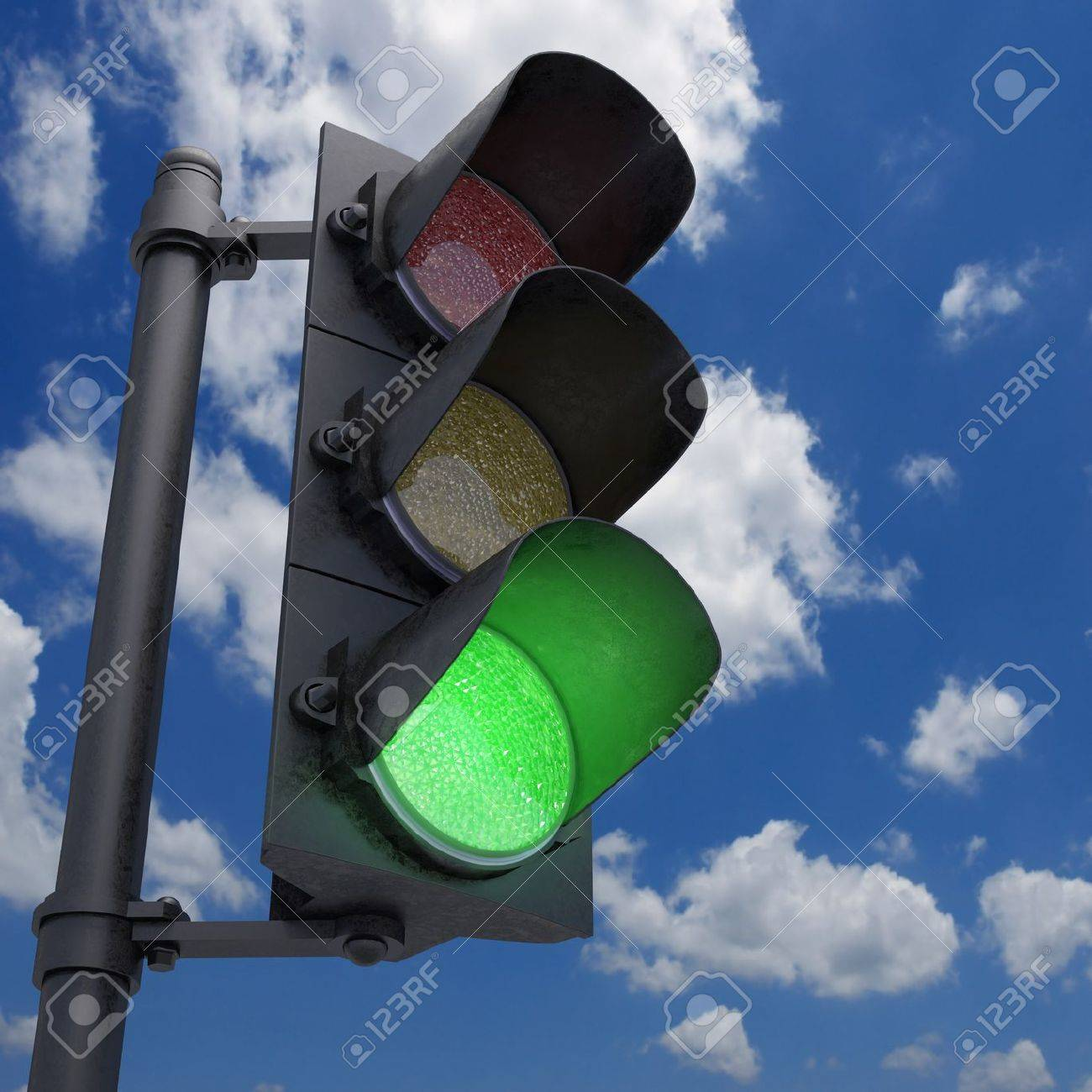 Traffic Light in a blue sky with only the green light on. - 17322884