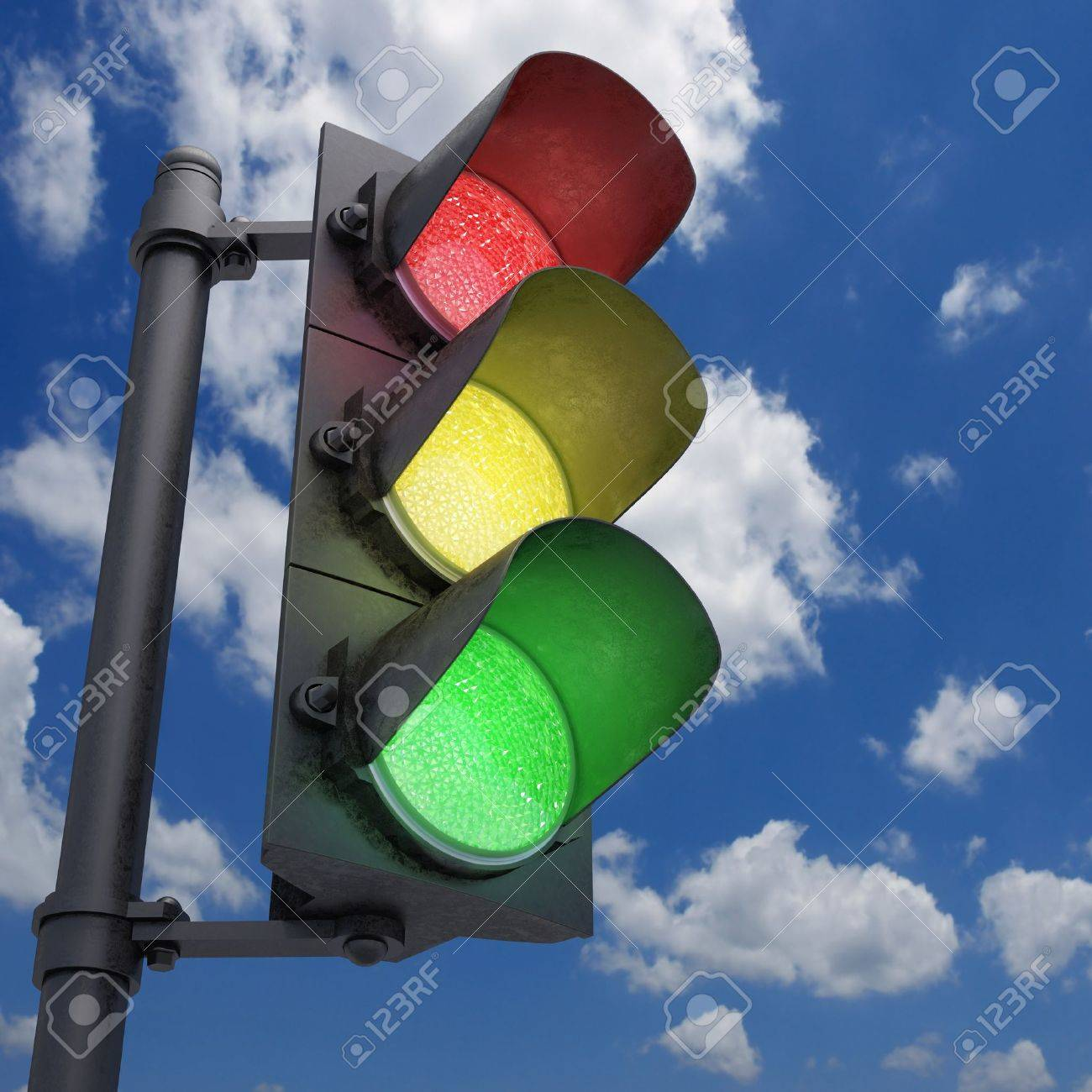 Traffic Light in a blue sky with all the lights on. - 17360332