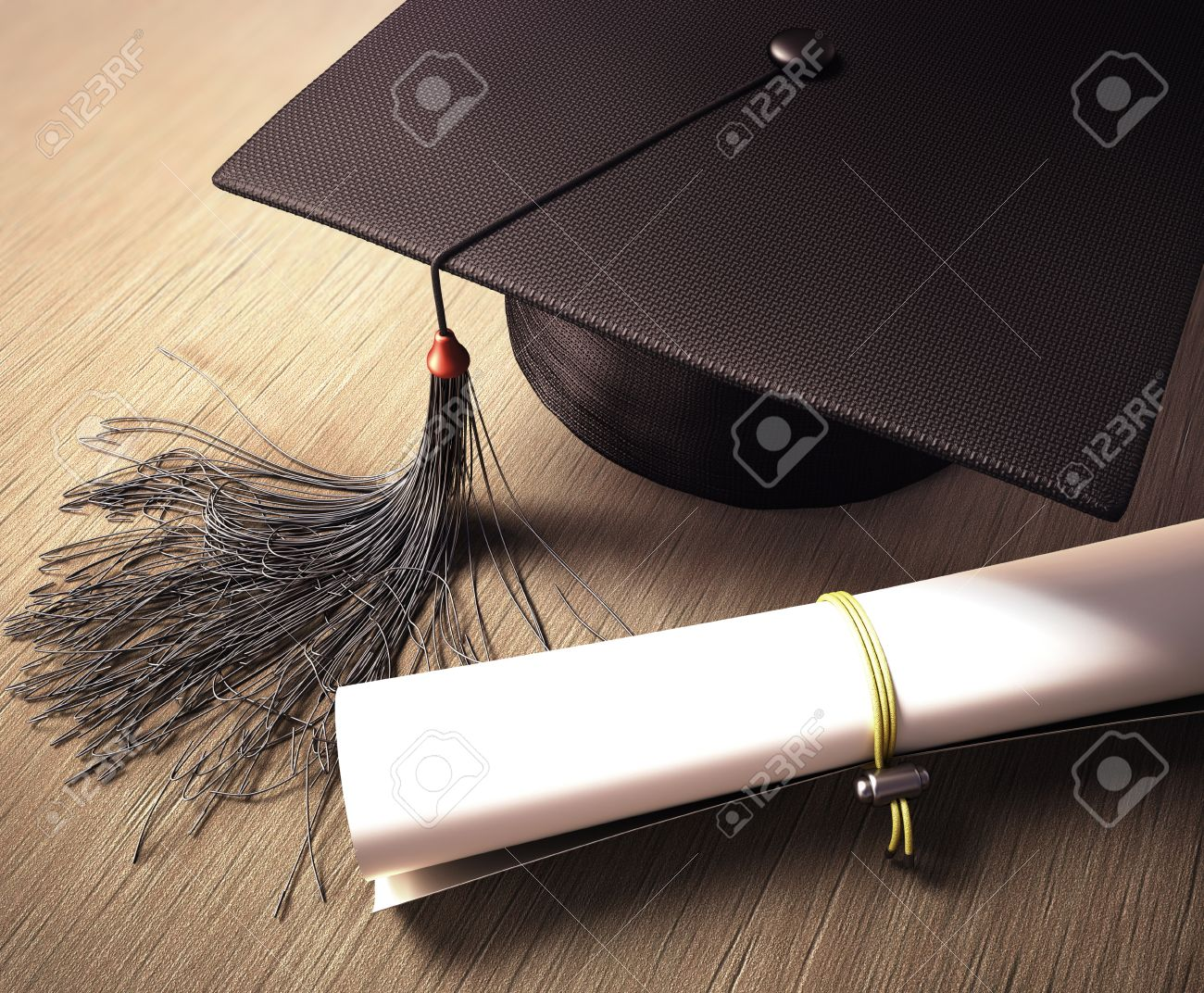 Graduation cap with diploma over the table. Clipping path included. - 27430463