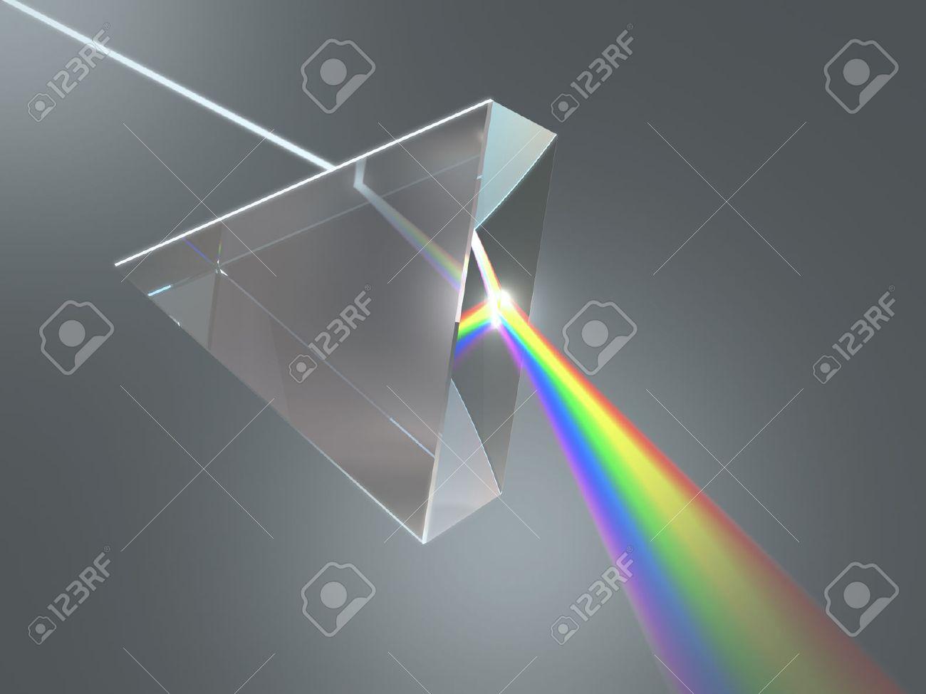 el prisma de cristal dispersa la luz blanca en los varios colores foto de archivo