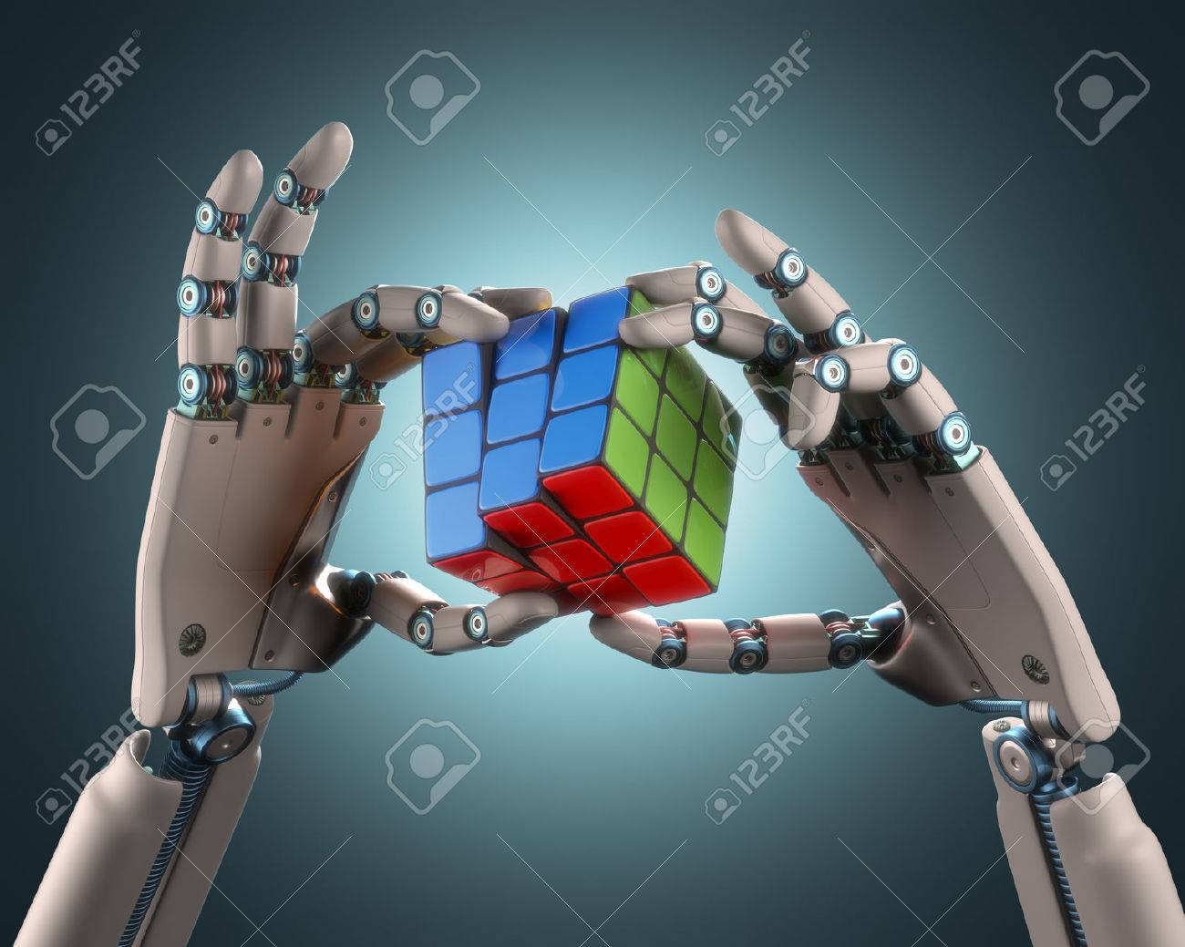 Robotic hand holding a colorful cube. Clipping path included. - 32817843