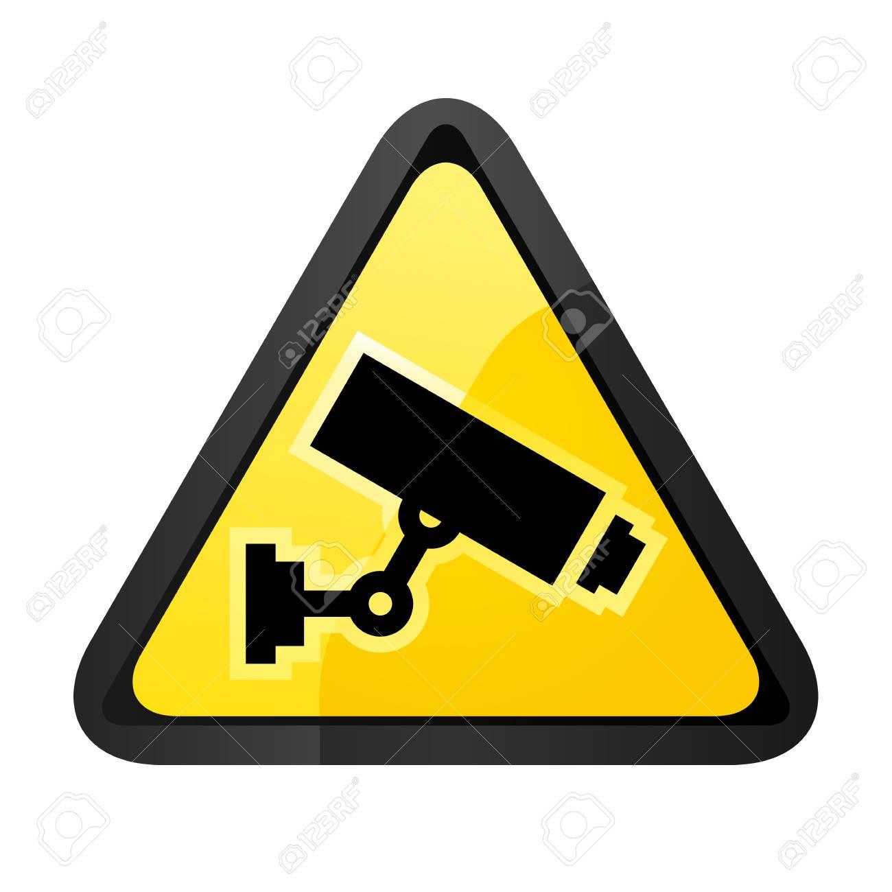 Black surveillance camera on a yellow triangular shape - 92437501