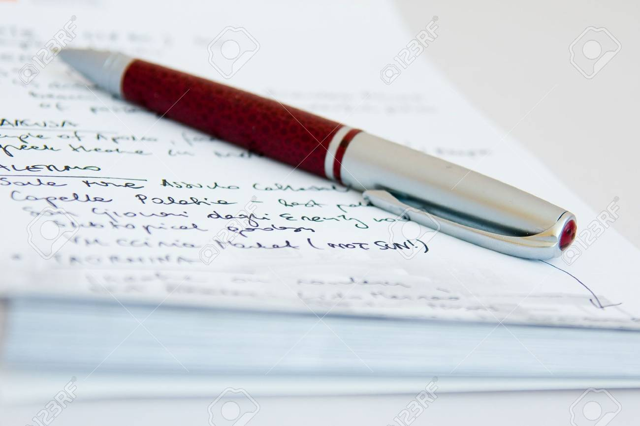 a close-up of notebook and a pen on it Stock Photo - 2919307