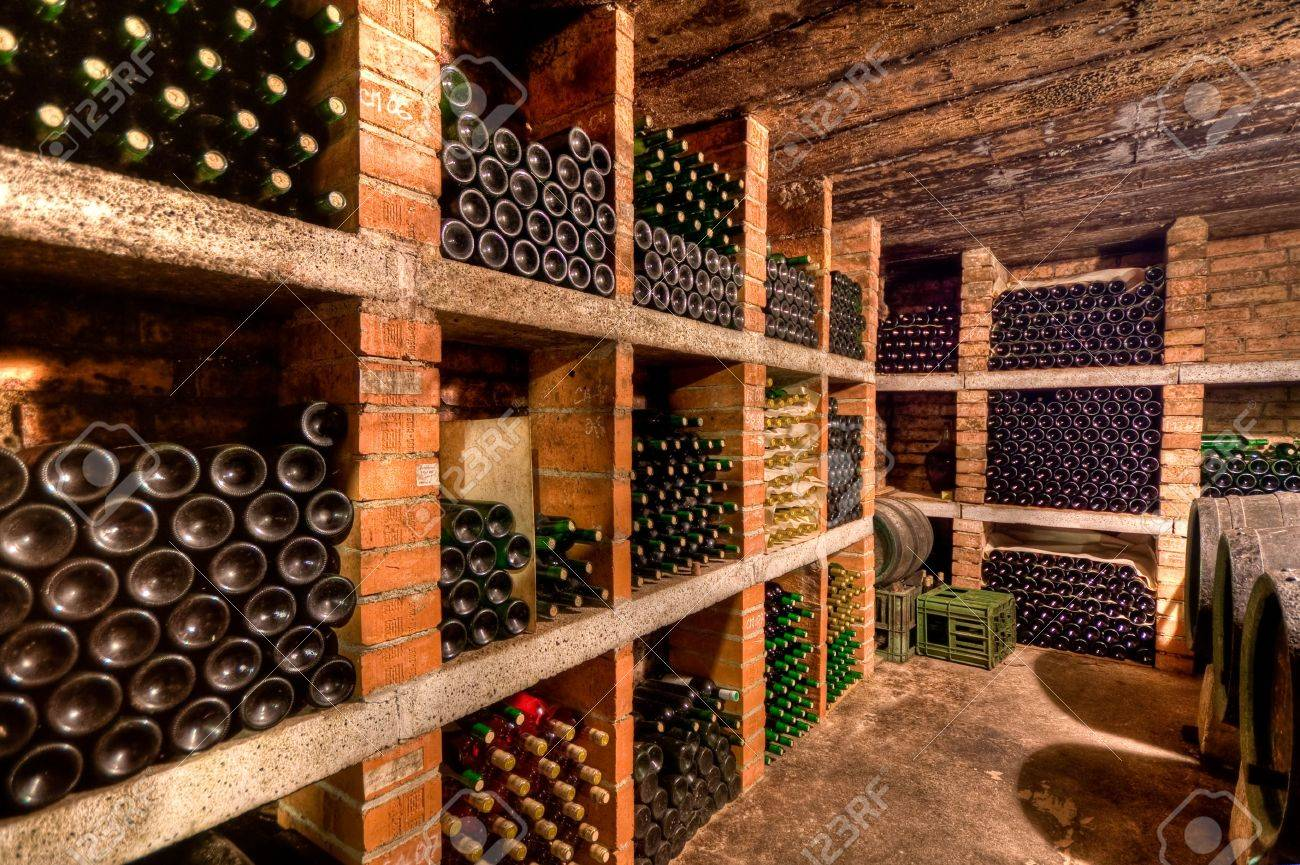 stacked up wine bottles in the cellar Stock Photo - 5099501