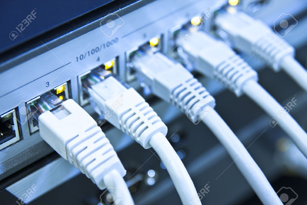 network cables RJ45 connected to a switch Stock Photo - 8552463