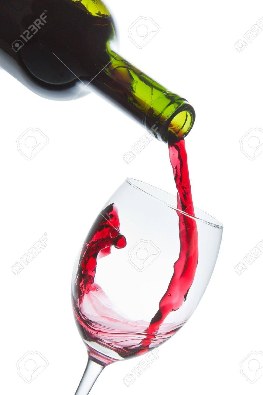 red wine pouring into wine glass isolated Stock Photo - 9576701