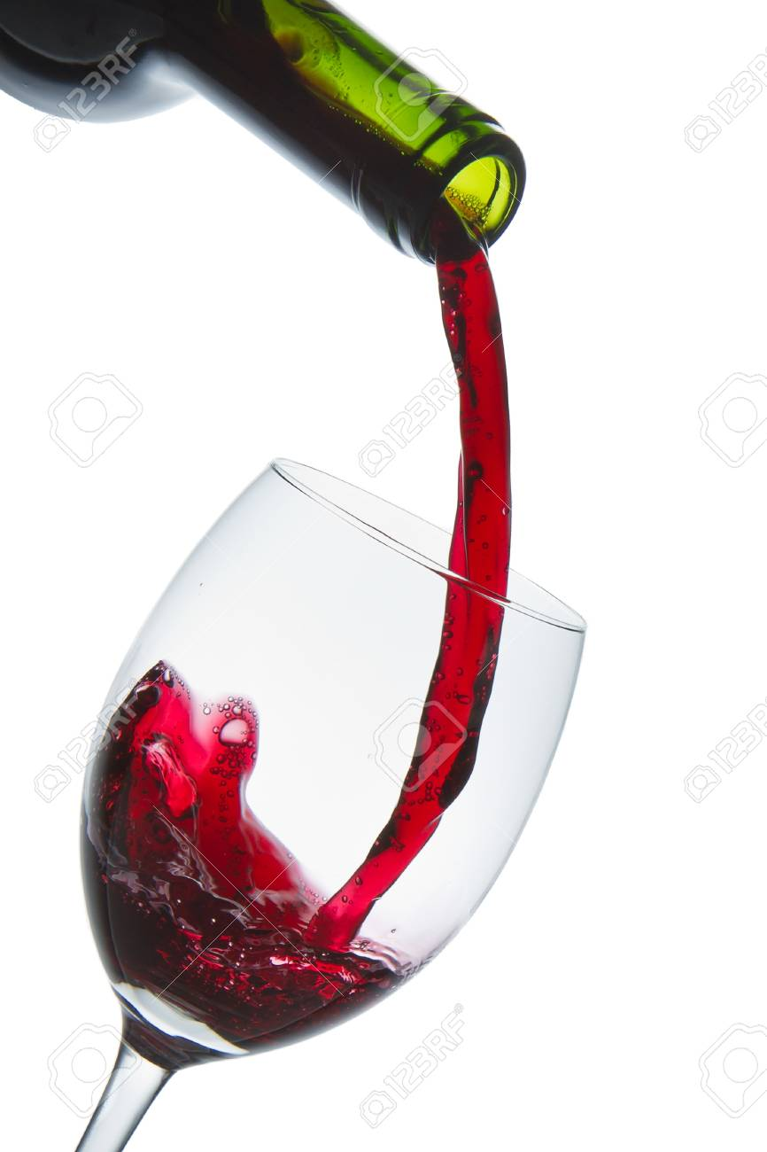 red wine pouring into wine glass isolated Stock Photo - 9651620