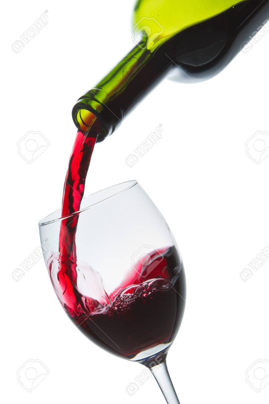 red wine pouring into wine glass isolated Stock Photo - 9651586