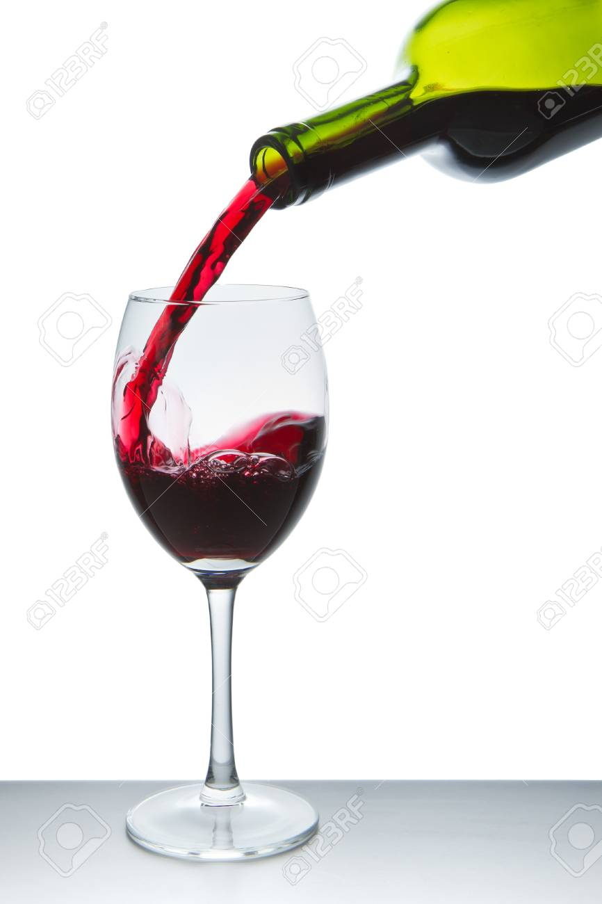 red wine pouring into wine glass isolated Stock Photo - 10024783