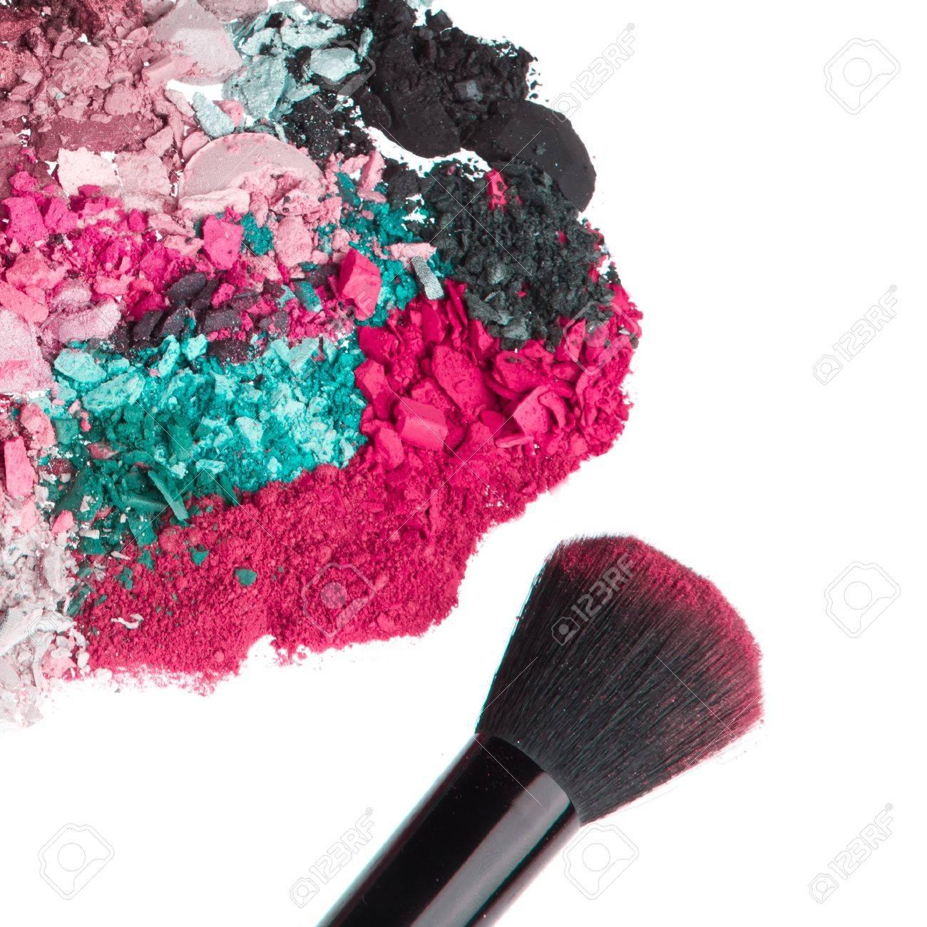 crushed eyeshadows with brush isolated on white background Stock Photo - 12306681