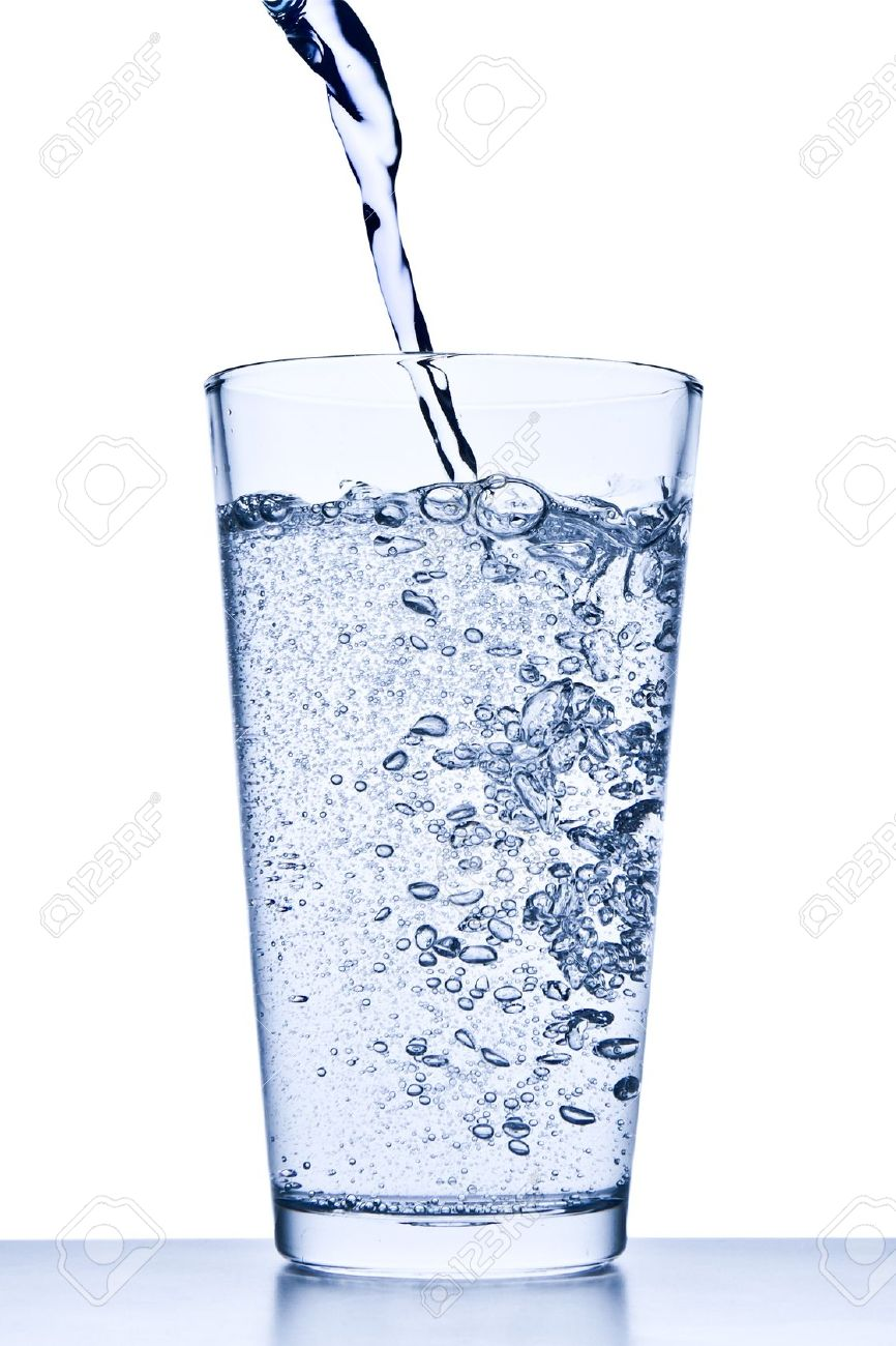 water pouring into glass on white background stock photo picture
