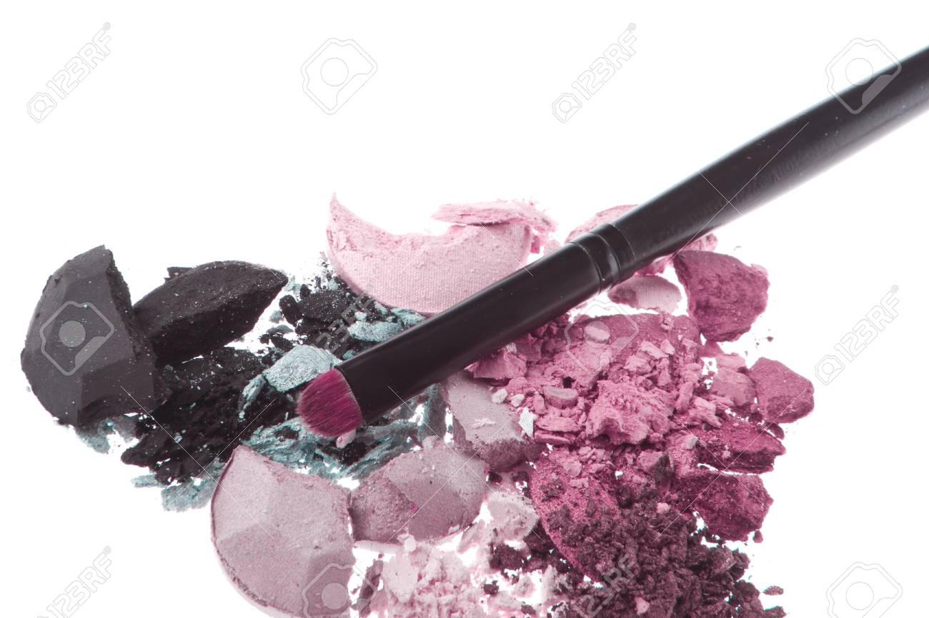 crushed eyeshadows with brush isolated on white background Stock Photo - 13098003