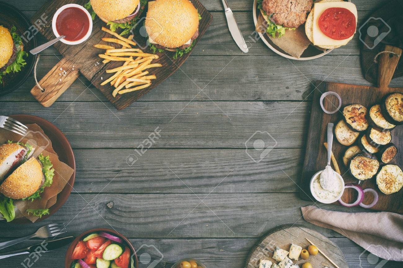 Frame from various food, burgers, salad, roquefort cheese and vegetables cooked on the grill, top view. Outdoors food Concept - 60234955