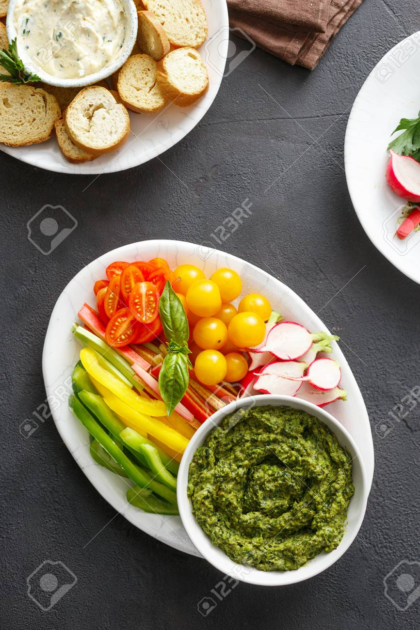 healthy snacks raw vegetables bread croutons with pesto sauce and
