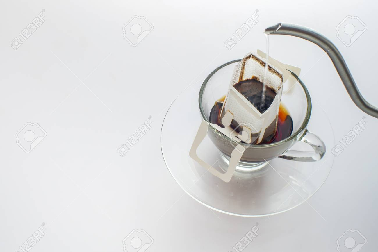 Making coffee with drip coffee bag on white background - 126115167