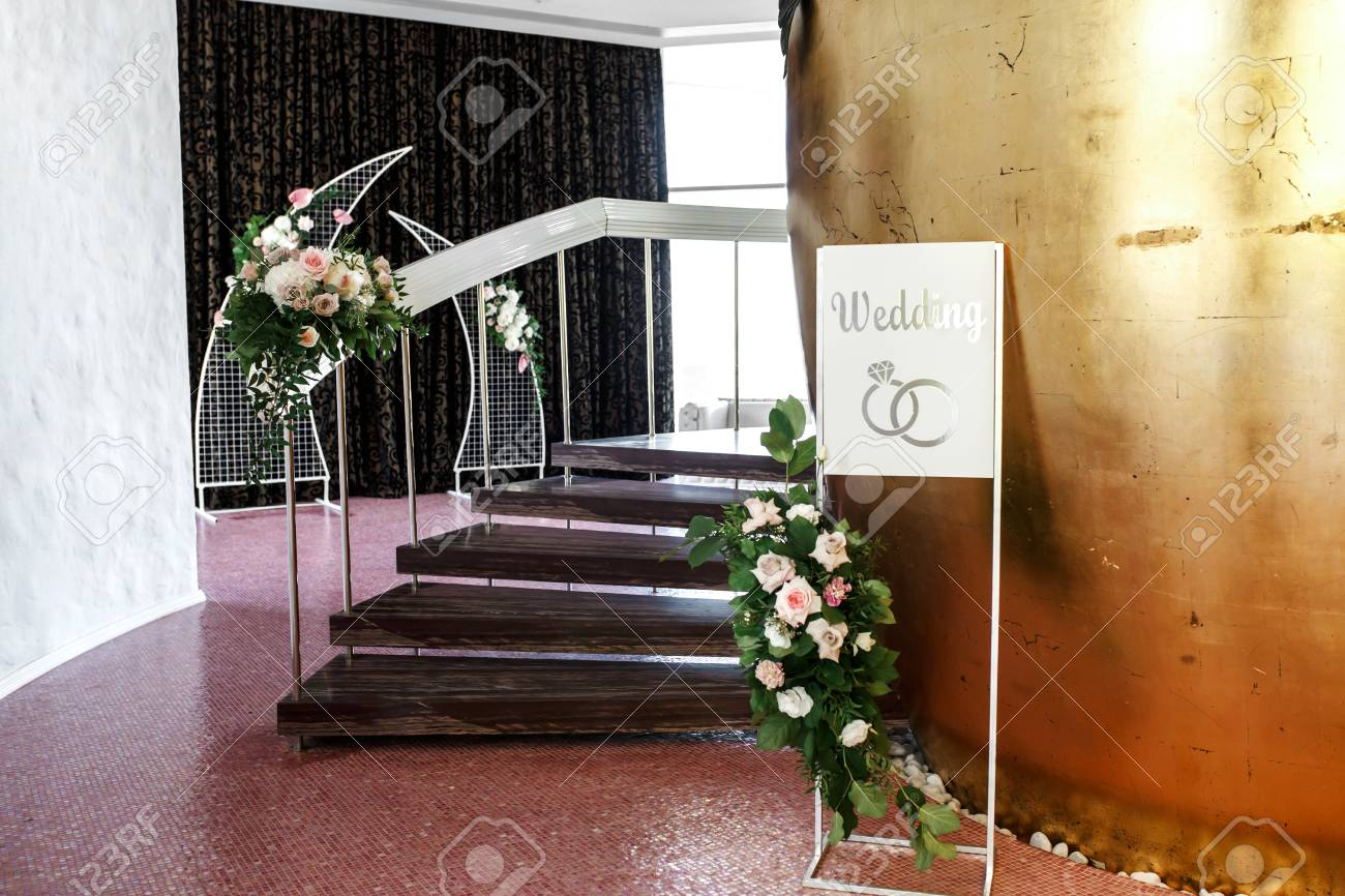 The Staircase Is Decorated With Fresh Flowers And A Plate Wedding Stock Photo Picture And Royalty Free Image Image 124868530