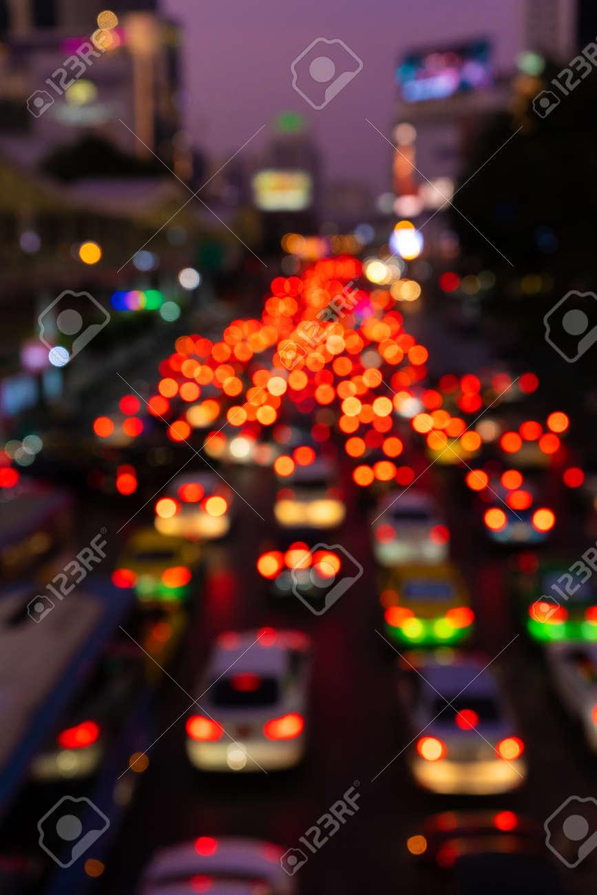 Blurred footage. Traffic jam on a wide street. Blurry brake lights. Dense city traffic. Transport interchange. Night footage - 144381076