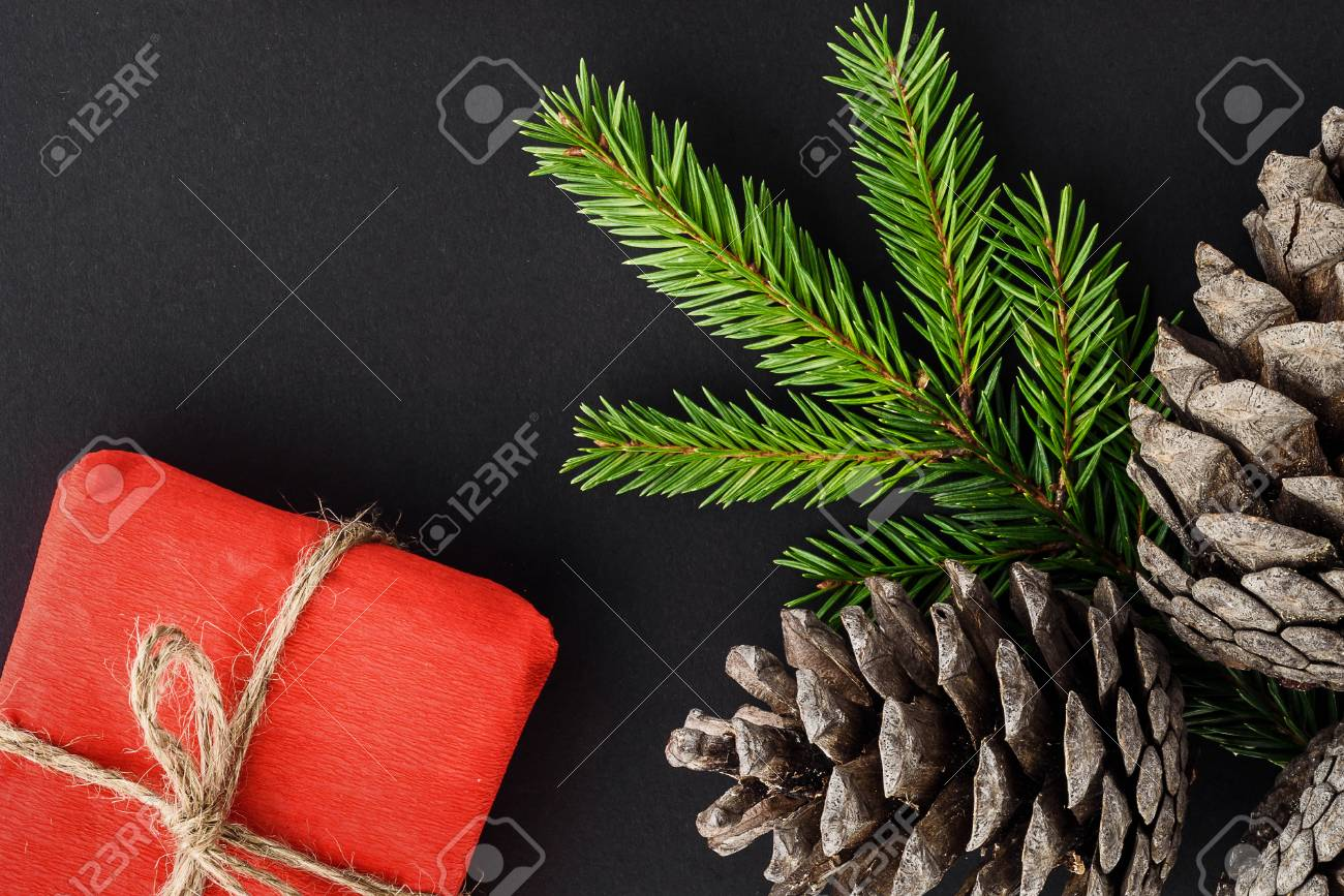 Christmas Composition On A Black Background. Gifts, Branches.. Stock ...