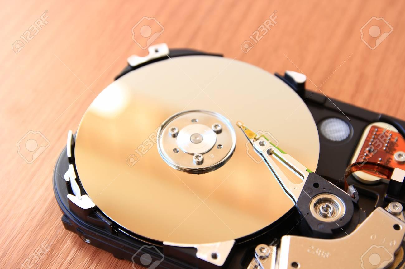 Open harddisk on wood desk Stock Photo - 16481032