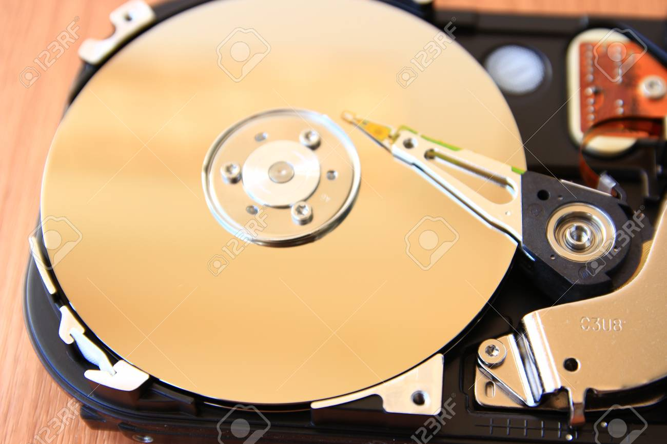 Open harddisk on wood desk Stock Photo - 16481031