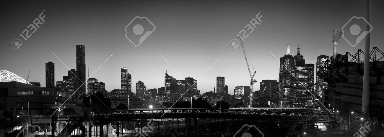 Melbourne skyline at night in black and white with railway and mcg stock photo 42138359