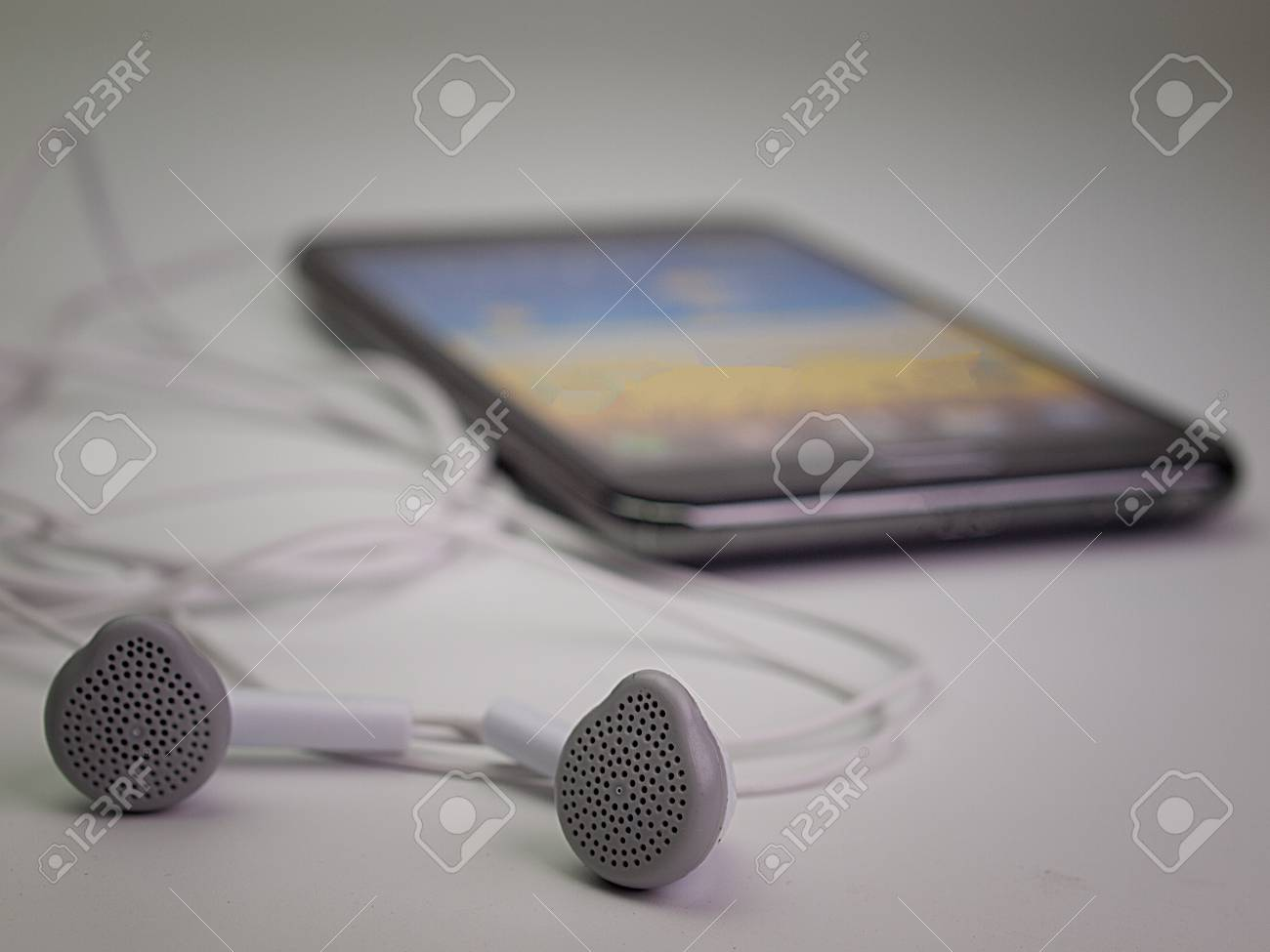 Close Up Mobile Phone Headset Placed On A White Background Stock Photo Picture And Royalty Free Image Image 71177033