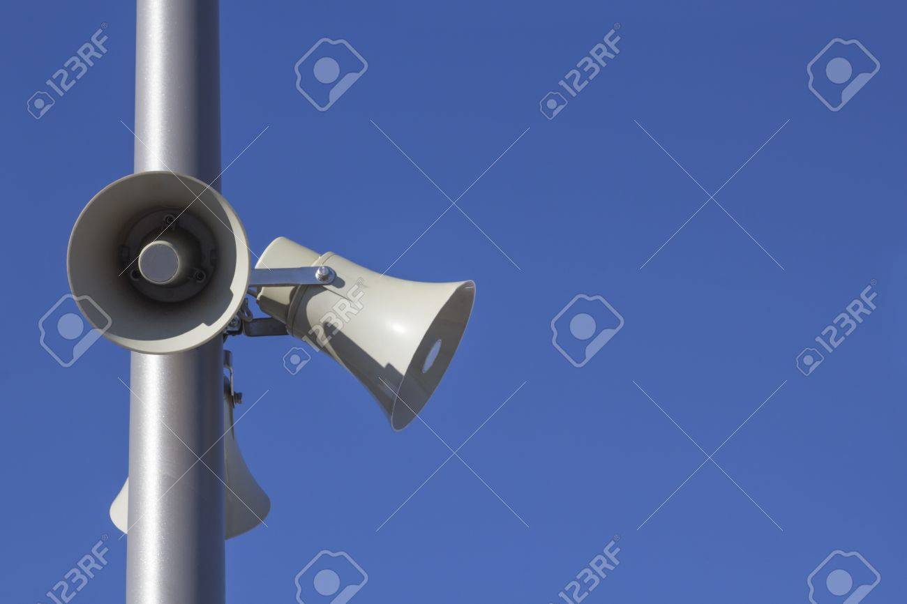 three Megaphones mounted to a silver pole on blue skies Stock Photo - 22011856