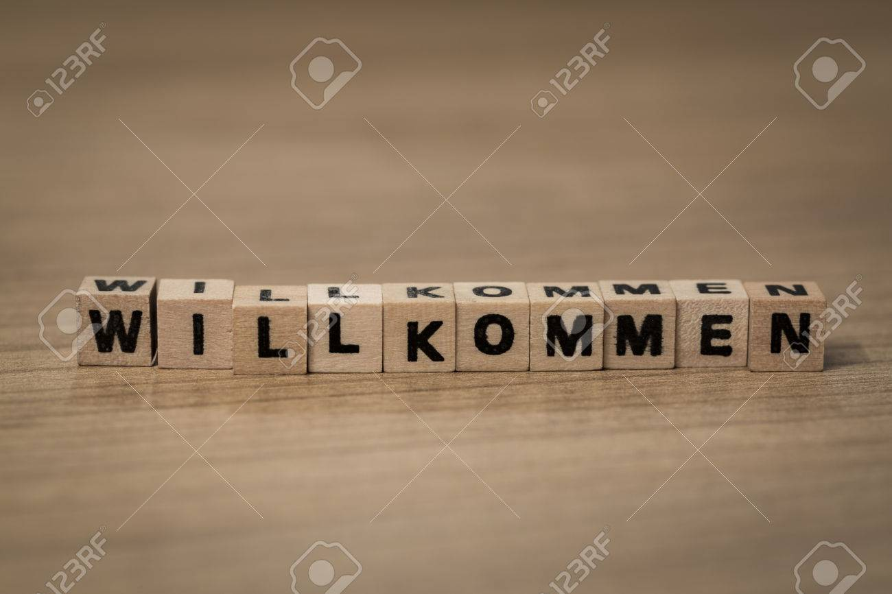 Willkommen bienvenue allemand écrit en cubes de bois sur un