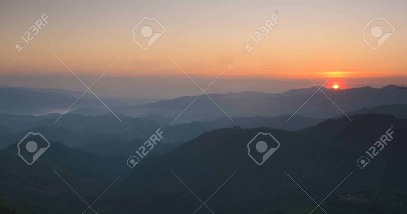 sunrise over black forest mist in Thailand Stock Photo - 17439945