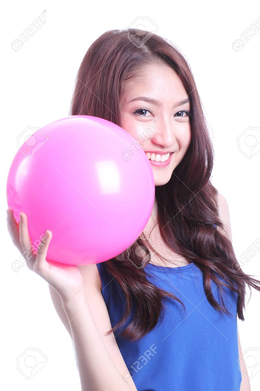 Asian woman playing pink ball on white background Stock Photo - 21365908