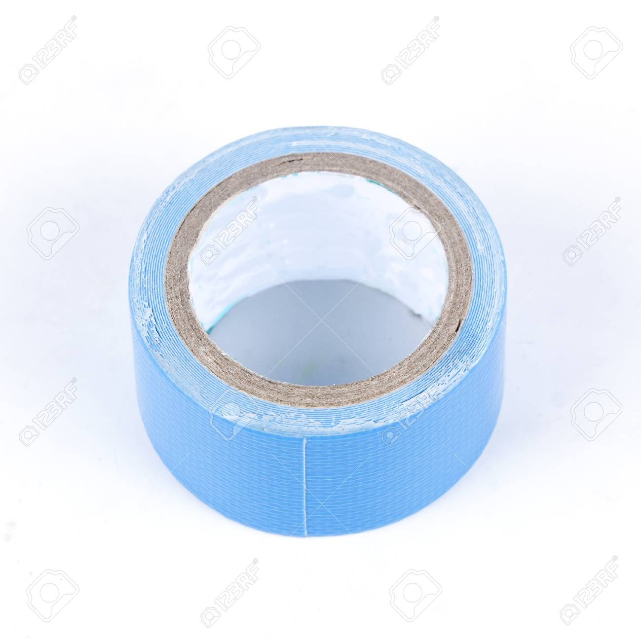 roll of blue painters tape isolated on white background stock photo 32937474 - Blue Painters Tape