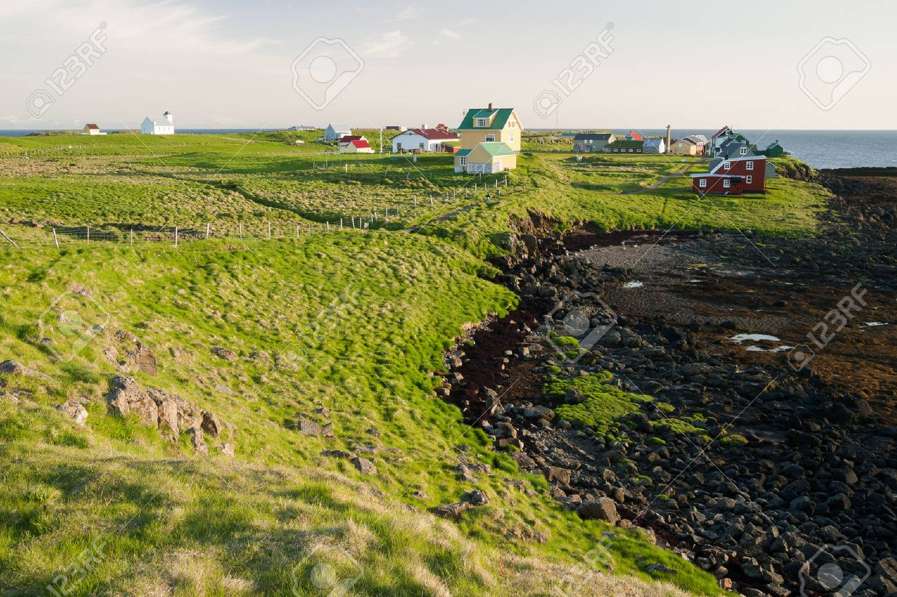 Little houses on Flatey island in Iceland at midnight - 68302878