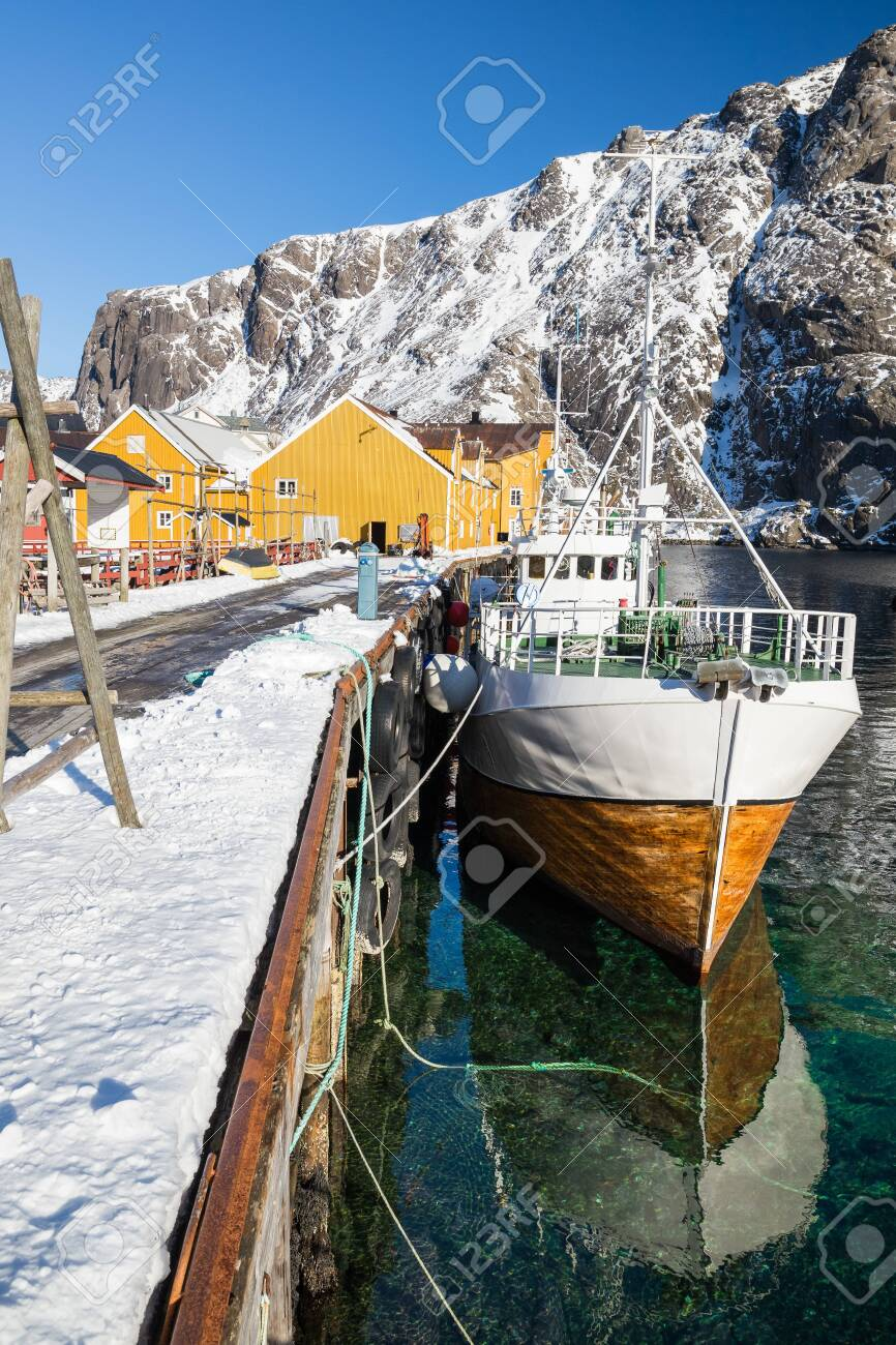 Little village Nusfjord on Lofoten islands during a sunny winter day - 133182001